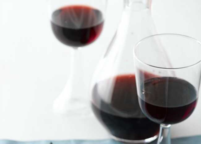 Red wine in glass and carafe